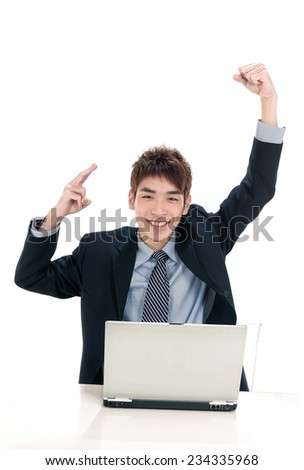 young business men with laptop with raised hands up - stock photo