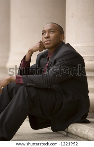 Young Business minded man dreams of future goals - stock photo