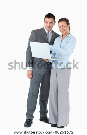 Young business partner with laptop against a white background