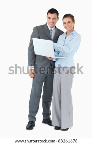 Young business partner with notebook against a white background - stock photo