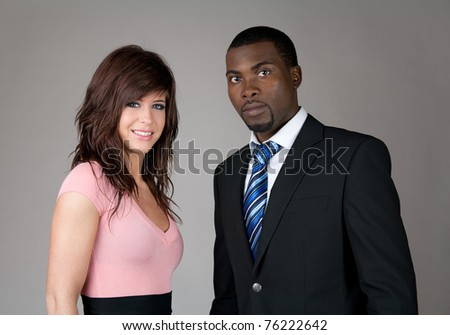 Young business partners, Caucasian woman and African American man.