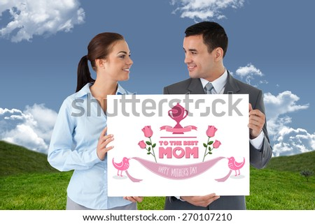 Young business partners presenting sign against field and sky - stock photo