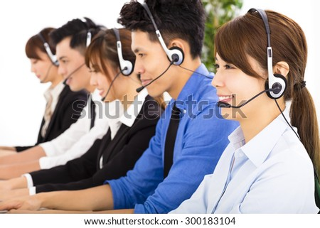 young business people and colleagues working in  call center  - stock photo