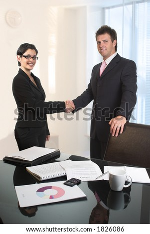Young business people are shaking hands after a business deal.