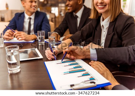 Young business people at a conference in the office - stock photo