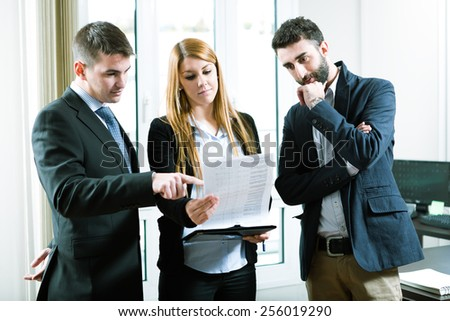 Young business people discuss the new project at office - stock photo
