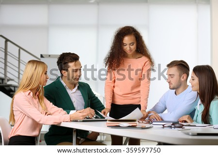 Young business people discussing a new project at the meeting in a conference room
