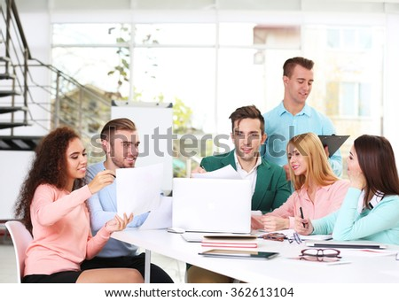 Young business people discussing a new project at the meeting in a conference room - stock photo