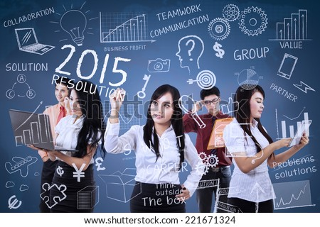 Young business people finding idea for make resolutions in 2015 - stock photo