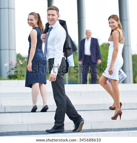 Young business people getting carrer in company through apprenticeship - stock photo