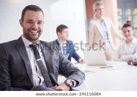 young business people group have meeting and working in modern bright office indoor - stock photo