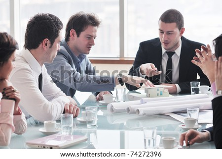 young business people group have  meeting at conference room and have discusion  about new ideas  plans and problem - stock photo