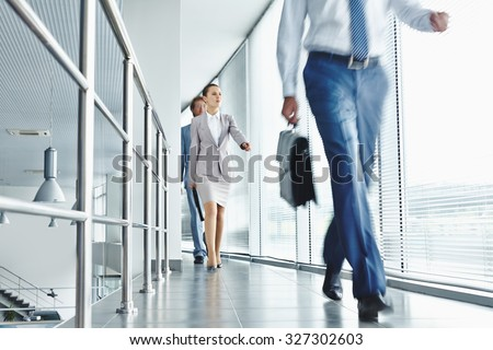 Young business people in formalwear going for work