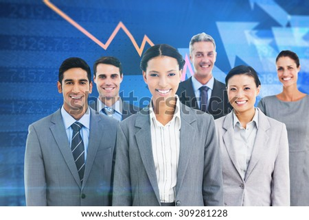 Young business people in office against stocks and shares - stock photo