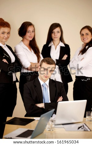 Young business people looking at the camera and workng together in the office. - stock photo