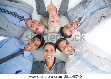 Young business people lying in circle on white background