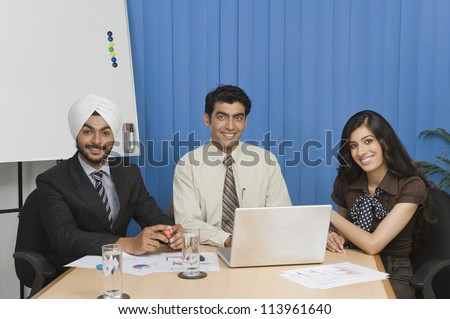 Young business people on meeting in an office - stock photo