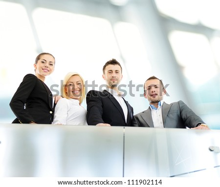 Young business people on railing - stock photo