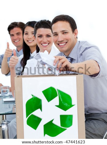 Young business people showing the concept of recycling against a white background