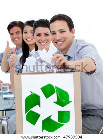 Young business people showing the concept of recycling against a white background - stock photo