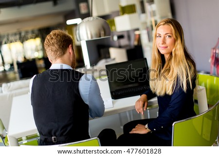 Young business people sitting in the office and working together