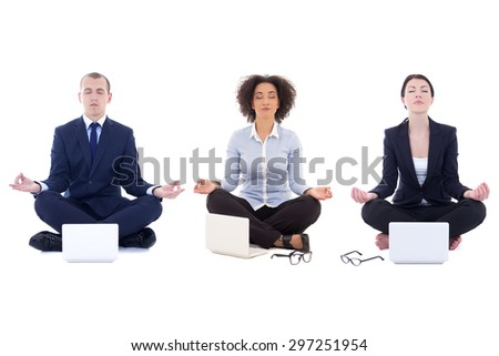 young business people sitting in yoga pose with laptops isolated on white background - stock photo