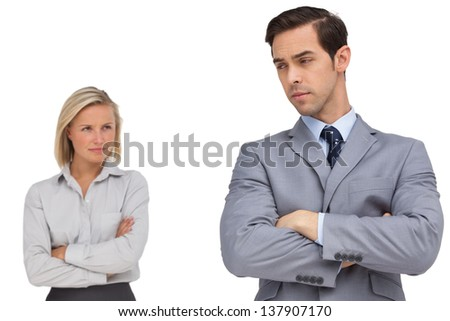 Young business people standing together showing rivalry on white background - stock photo