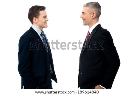 Young business people talking to each other - stock photo