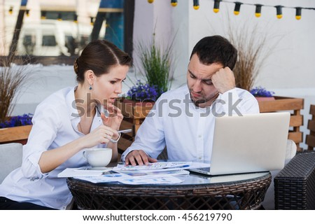 Young Business people tired working In Front Of Computer At Desk to coffee cafe