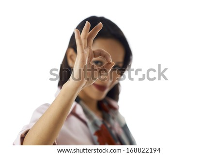 Young business people, work and positive message, portrait of happy Asian girl doing ok sign with hand, smiling at camera - stock photo
