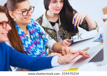 Young business people working at office on new project. - stock photo
