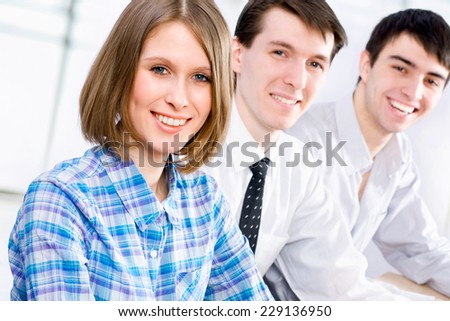 Young business people working at the workshop - stock photo