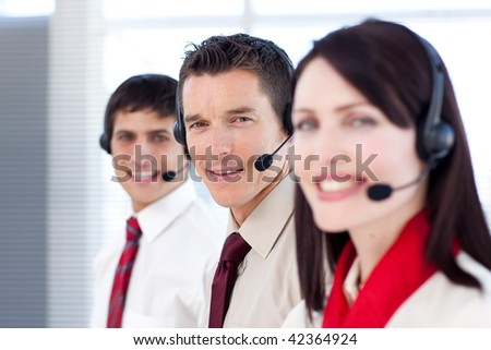 Young business people working in a call center. Business concept. - stock photo