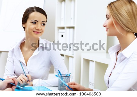 Young business people working in office together - stock photo