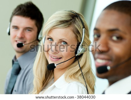 Young business people working in the office with headsets