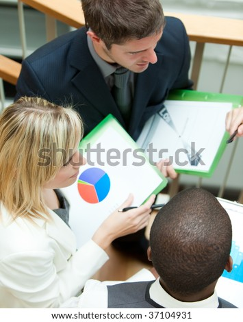 Young business people working on stairs - stock photo
