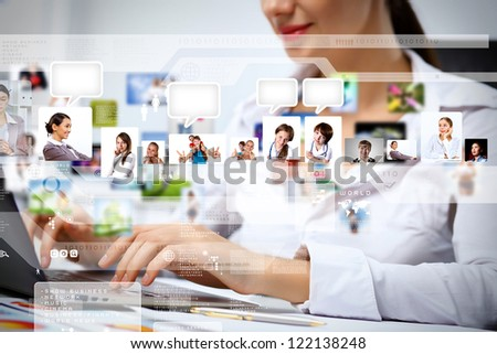Young business person working with a notebook - stock photo