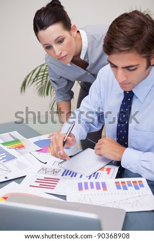 Young business team analyzing statistics together