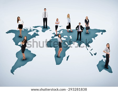 Young business team on world map - stock photo