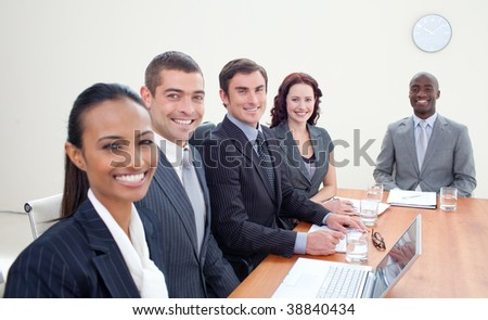 Young business team talking in a meeting - stock photo