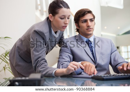 Young business team working on pc together