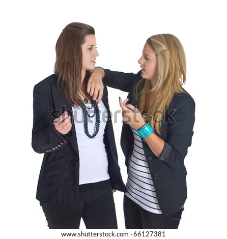 Young business teenaged girls isolated over white background
