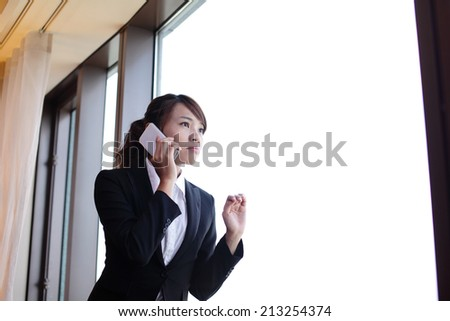 Young business travel woman using smart phone in her hotel room, asian - stock photo