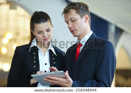 Young business woman and businessman in the hallway