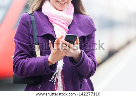 Young Business Woman at Station - stock photo