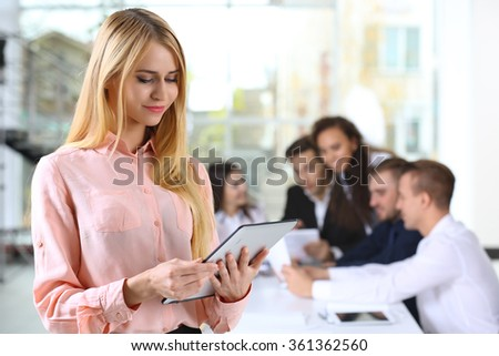 Young business woman at the meeting in a conference room