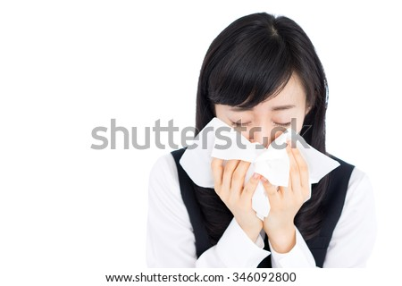 young business woman blowing her nose, isolated on white background - stock photo