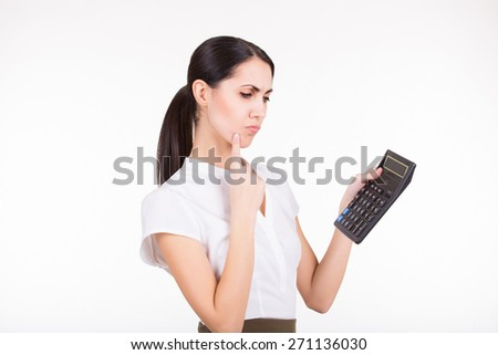 Young business woman calculating finance and thinking - stock photo