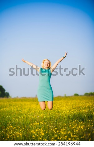 Young  business woman celebrating her success outside after hard day in office. Freedom concept. Lady having fun in spring or summer meadow. Free happy girl portrait. Successful person. Success.