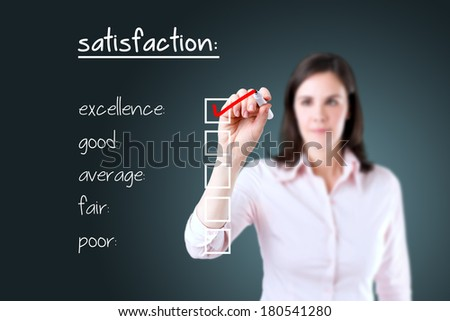 Young business woman checking excellence on customer satisfaction survey form.  - stock photo